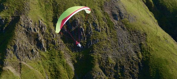 Patrick flying Gin Gliders' Calypso above UK Airsports office